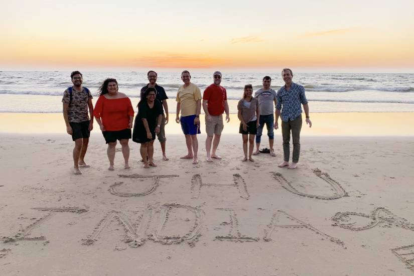 A group of people on a beach with