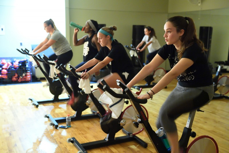 A group of women on spin bikes