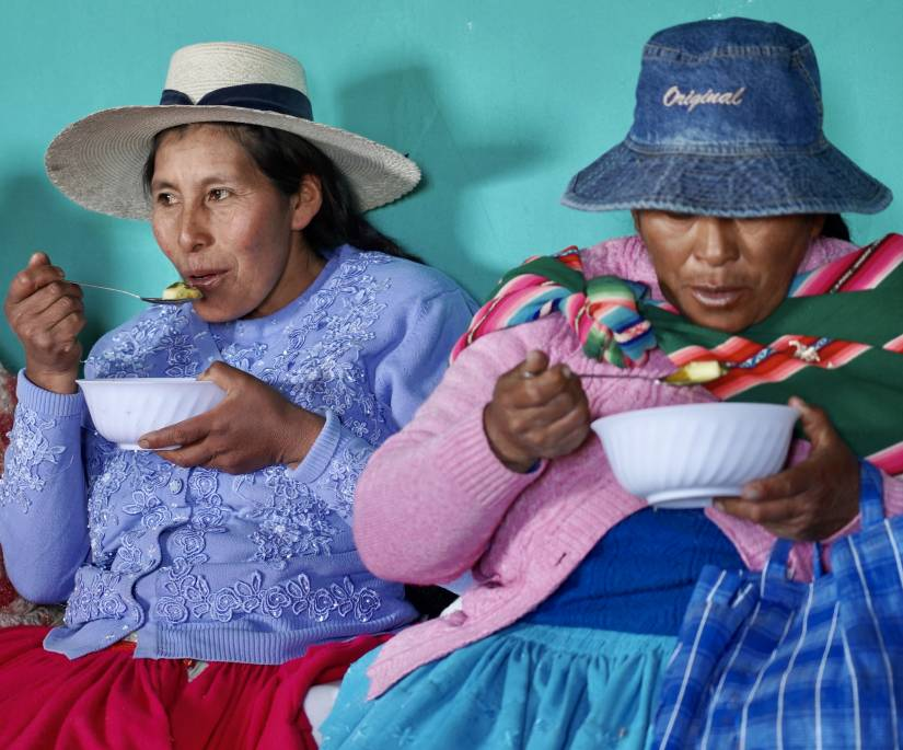 Women taste soup prepared using the thermal cooker