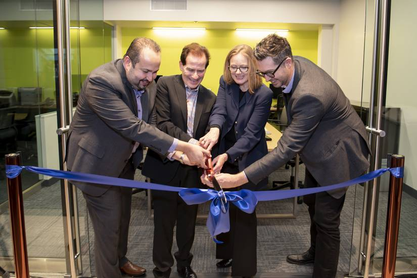 From left: Farouk Dey, Fred Bronstein, Sarah Hoover, and Zane Forshee cut the ribbon on the new LAUNCHPad office space