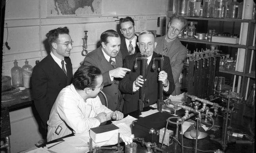 Warburg with colleagues in a laboratory