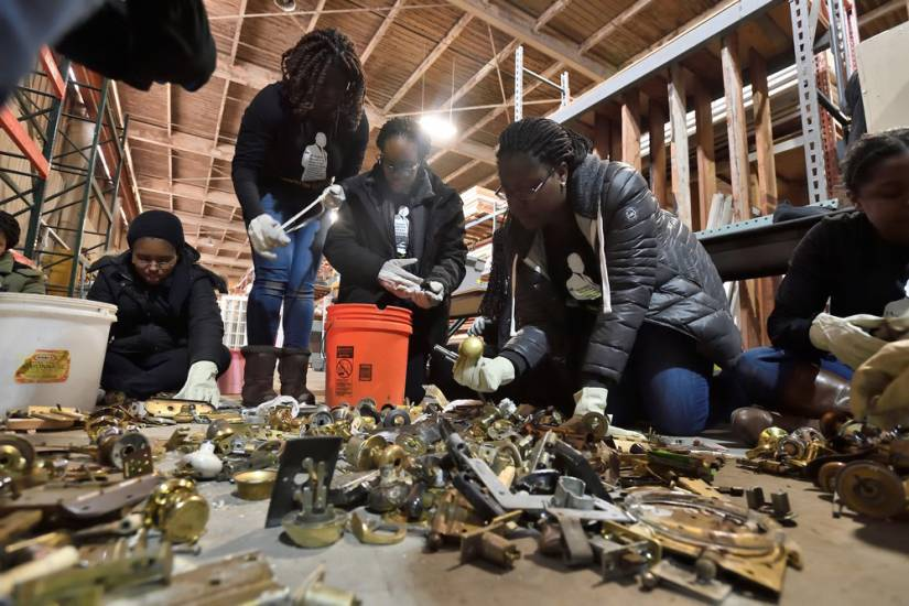 Students sort and organize scrap material at Second Chance Baltimore