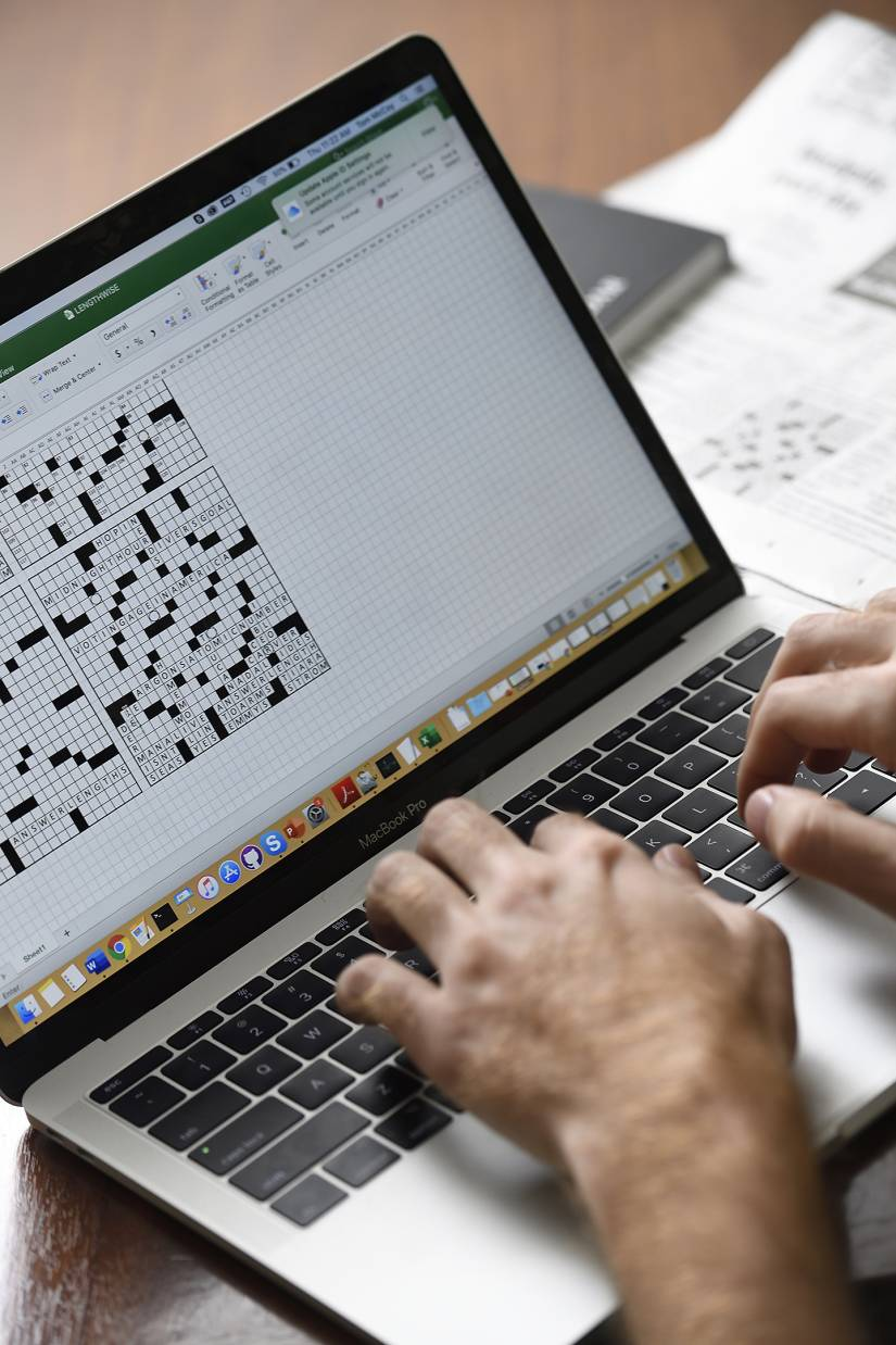 McCoy working on a draft crossword using Excel