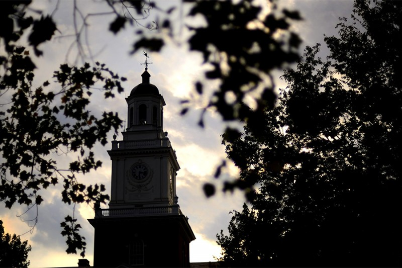 Gilman Hall tower silhouette at sunset