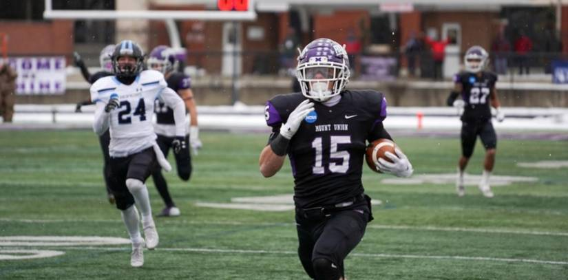 Mount Union defender returns an interception for a touchdown