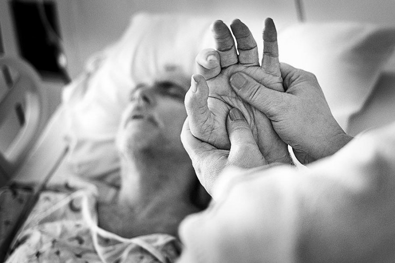 A hospital patient has a hand massage