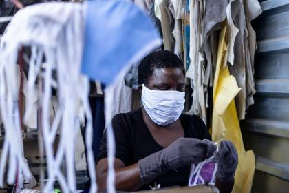 A woman works in a face mask manufacturing shop in a factory in Harare, Zimbabwe