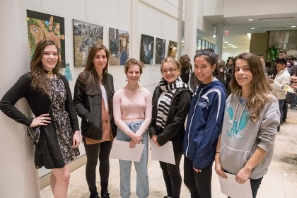 Six student artists pose for a photo