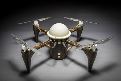 Small drone with white, domed center and four propellors