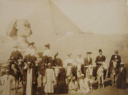 Aged photograph of men on horseback before the Sphinx