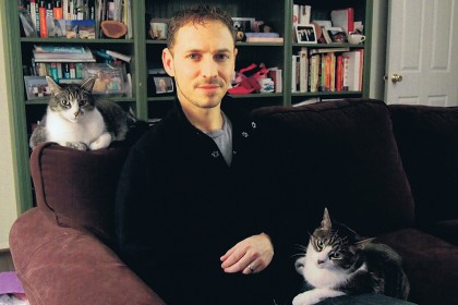 Science writer David Grimm with his pet cats, Jasper and Jezebel