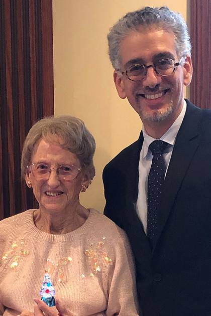 Jane Hixson and Josef Coresh, director of the Comstock Center, celebrate the holidays in 2019.
