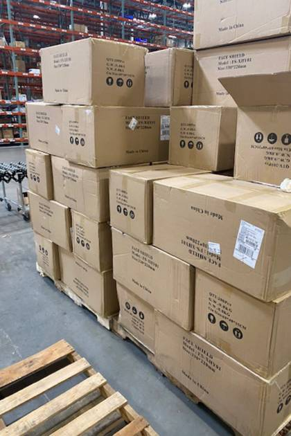 Boxes of face masks and shields