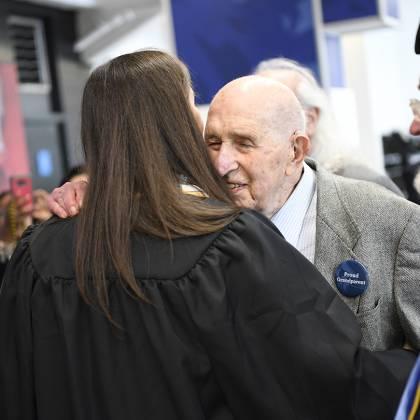 Seymour Baron hugs his granddaughter with a