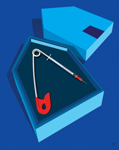 Illustration shows a safety pin with a disposable needle on the end, encased in a house-shaped box