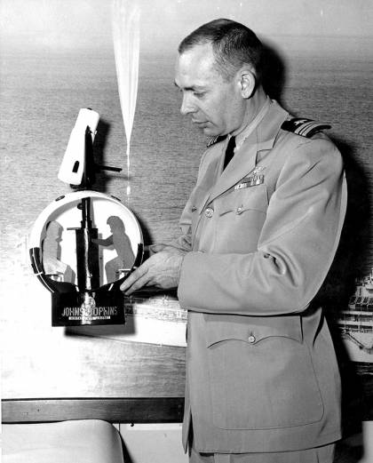 Navy captain shows a model