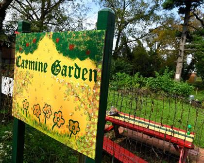 Carmine Garden sign