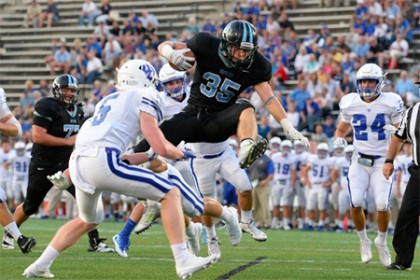 Ryan Cary hurdles into the end zone