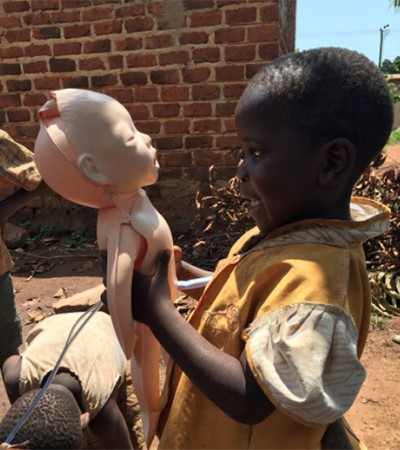 A child in Uganda looks at the medical manikin