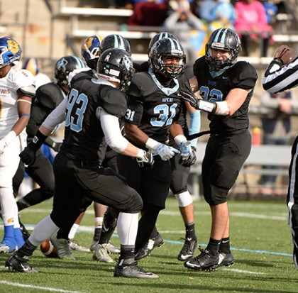 JHU players celebrate after a turnover