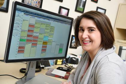 Chelsea Buyalos looks at the performance calendar on her monitor