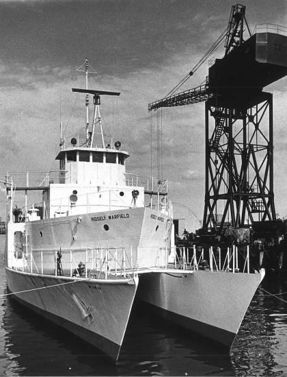 Ridgely Warfield docked beside large crane