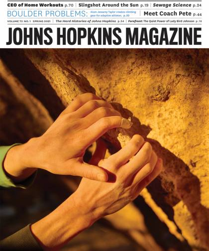 cover image of Johns Hopkins Magazine, featuring a closeup of the hands of climber Jessamy Taylor