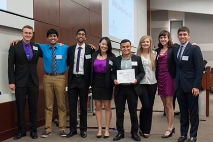 The eight team members from CricSpike pose at a design competition