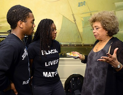 Angela Davis speaks with two students