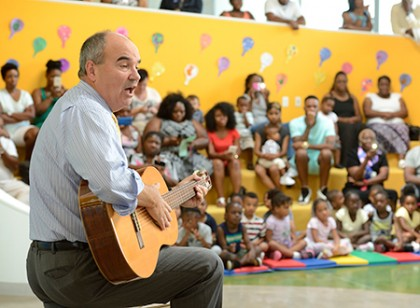 David Andrews plays guitar and sings