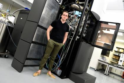 Ed Twomey stands in front of the Titan Krios microscope
