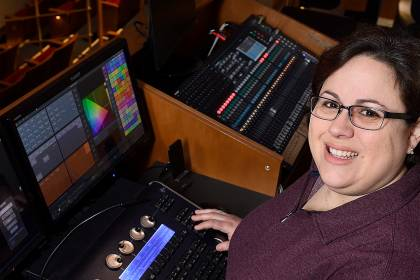 Heather Michaelson at the control booth on the balcony