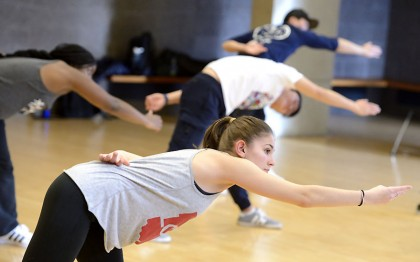 Students stretching before hip-hop class