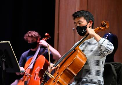 HSO string players practice while wearing masks