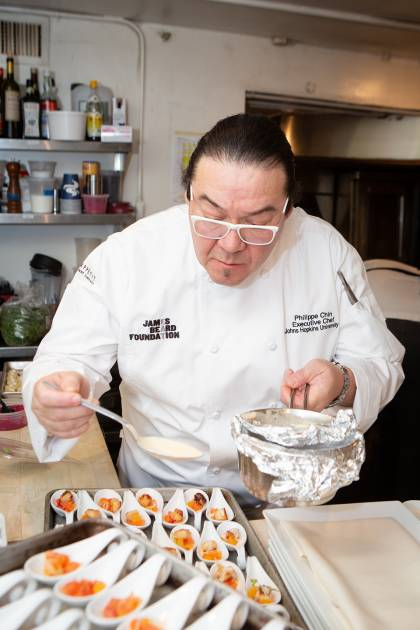Chef Chin plates an hors d'oeuvre