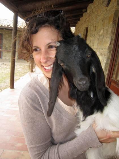 Jessica Fanzo hugs a goat