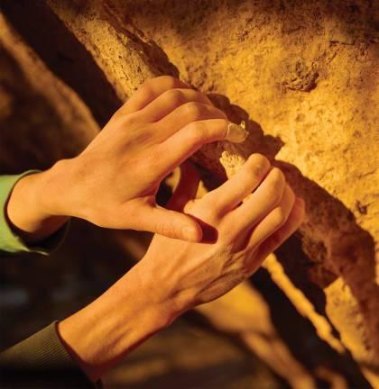 closeup of Jessamy Taylor's hands as she rock climbs