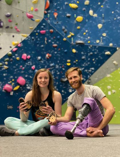 Jessamy Taylor and Jono Lewis at a climbing gym
