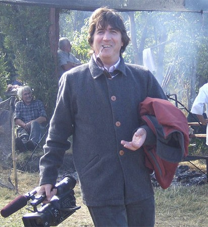 Filmmaker Kerry Candaele with camera in Chile
