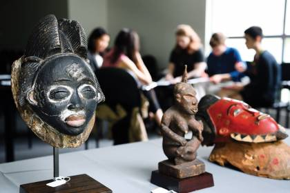 A pair of African masks and a wooden figurine