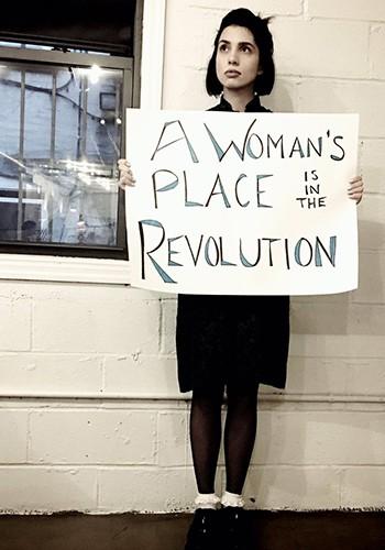 Nadya Tolokonnikova holds a sign reading