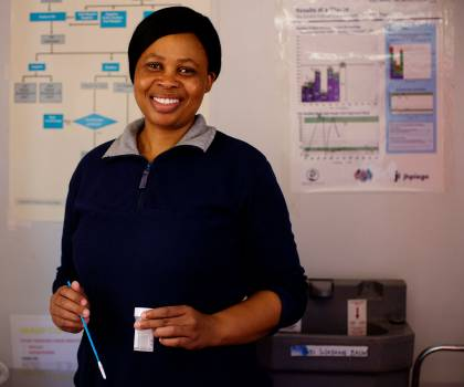 Nurse Motlalepula Masiele holds a cervical cancer screening tool