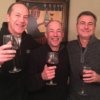 Three men cheers at New Year's Eve