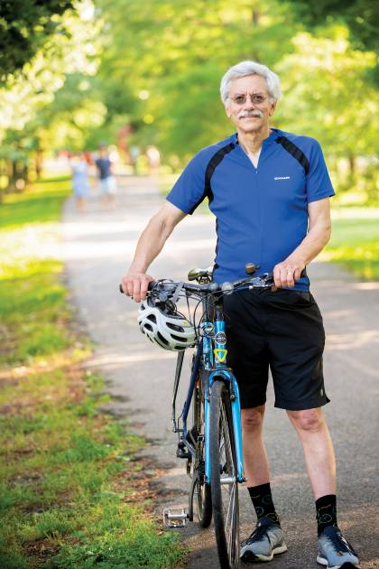 Peter Harnik stands next to his bike on the Washington & Old Dominion Trail.