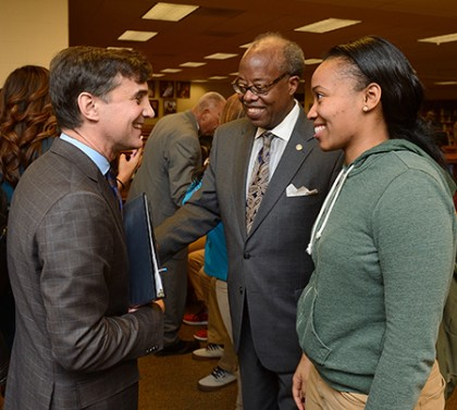 JHU President Ron Daniels speaks with a high school student