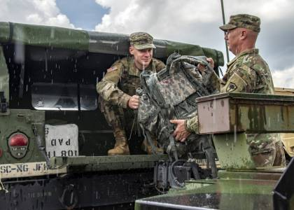 National Guard soldiers load a Humvee