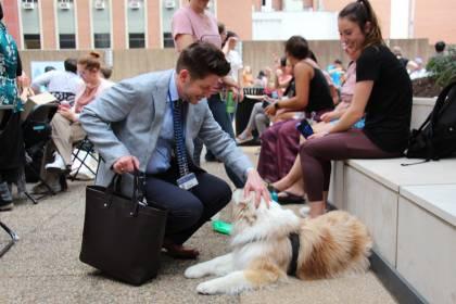 Kevin Shollenberger pets a dog