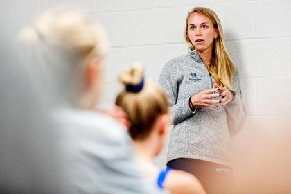 Assistant coach Kim Lewnes at a pre-meet strategy session.
