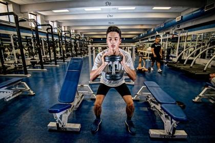 Alex Doran doing squats in the varsity weight room.