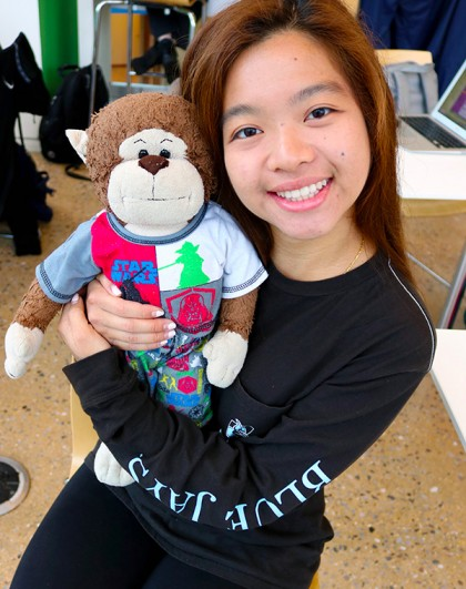 Tiffany Chan poses with stuffed monkey